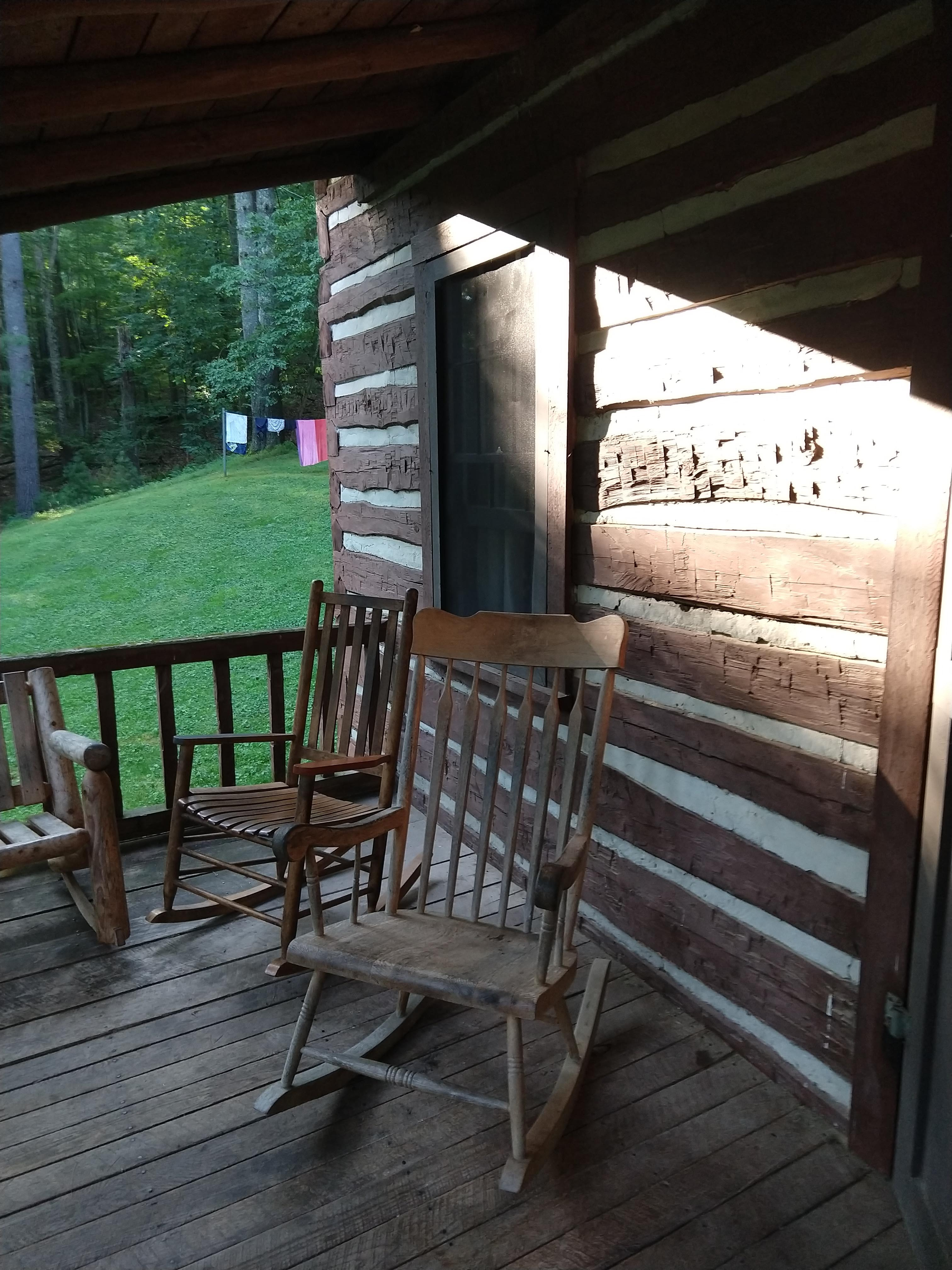 Front porch with rocking chairs at Lost River State Park log cabin